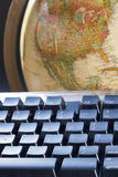 World at your fingertips. Earth globe and computer keyboard Stock Images