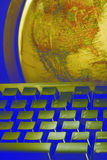 World at your fingertips. Earth globe and computer keyboard with distorted colors Royalty Free Stock Photo