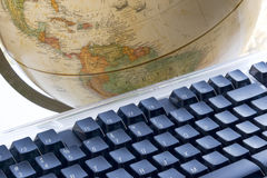 World at your fingertips. Earth globe and computer keyboard Royalty Free Stock Images