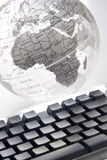 World at your fingertips. Earth globe and computer keyboard Royalty Free Stock Image