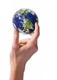 World at your fingertips. Female hand holding earth globe Stock Photos