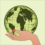 The World in your hand. Globe in green color being held by female hand - protection, environment, peace concept Stock Photography