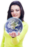 World in your hands. Conceptual image of the world in the hand of a woman with DOF Royalty Free Stock Image