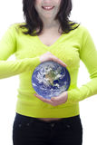 World in your hands. Conceptual image of the world in the hand of a woman Royalty Free Stock Photo