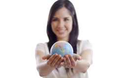 The world is in your hands. Cute girl handing over the world to you Stock Photos