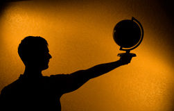World in your hands - silhouette of man Stock Photography