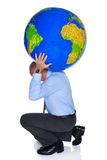 World on your shoulders. Photo of a businessman with a large globe on his shoulders, isolated on a white background. Concept image to represent the phrase Royalty Free Stock Photos