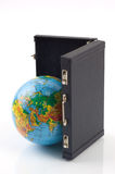 The world in your suitcase. Little globe and a black suitcase against the white background stock photography