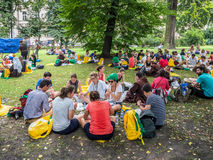 World Youth Day 2016. Picnic in the Planty Park in Cracow. KRAKOW, POLAND – JULY 29, 2016:. World Youth Day 2016. Young people from various countries sitting Stock Images