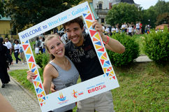 World Youth Day 2016 in Trzebnica. TRZEBNICA, POLAND - JULY 25: World Youth Day, pilgrims couple pose with Wroclaw's welcome frame in front of St. Jadwiga royalty free stock photography