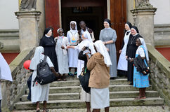 World Youth Day 2016 in Trzebnica. TRZEBNICA, POLAND - JULY 25: World Youth Day, Polish and Senegal nuns take photo together in front of St. Jadwiga Sanctuary on Stock Images