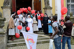 World Youth Day 2016 in Trzebnica. TRZEBNICA, POLAND - JULY 25: World Youth Day, Polish and Senegal nuns take photo together in front of St. Jadwiga Sanctuary on Stock Photography