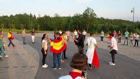 World Youth Day 2016. Young pilgrims from many countries singing and dancing in a circle stock video