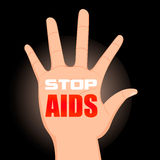 Worlds Aids day. Hand with the words Stop . Stock Photos