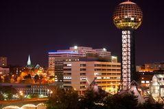 Worlds Fair Park. And Knoxville Tennessee skyline at night showing the Sunsphere, bridge, office buildings at the center of the park. Fall colors in trees on Stock Photography