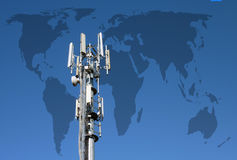 Worldwide communications. Closeup of transmitter tower against World outline map Stock Image