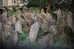 Worldwide famous old Jewish cemetery in Prague, Czech Republic with its cluttered gravestones as a religious symbol of the Jews in royalty free stock photography