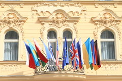 Worldwide flags. Flags from all around the world (Czech Republic, USA, United Kingdom, Ukraine, Germany, Eurpean Union and others) on bacony of yellow historic stock photography