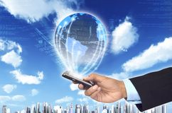 Worldwide information with smart phone Stock Photo