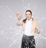 Worldwide network or wireless internet connection futuristic concept. Woman working with linked dots. royalty free stock photography