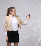 Worldwide network or wireless internet connection futuristic concept. Woman working with linked dots. Royalty Free Stock Image