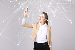 Worldwide network or wireless internet connection futuristic concept. Woman working with linked dots. stock photography