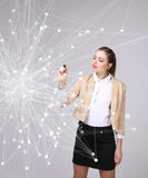 Worldwide network or wireless internet connection futuristic concept. Woman working with linked dots. Stock Photo
