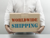 Worldwide Shipping brown paper box Stock Image