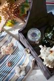 Worldwide trade concept: coffee, wine, cotton fabrics and seashe Stock Image