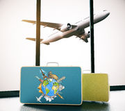 Worldwide travel concept. Airport interior with globe drawn on suitcase and plane view. Worldwide travel concept. 3D Rendering Royalty Free Stock Photo
