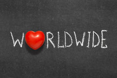 Worldwide. Word handwritten on chalkboard with heart symbol instead of O royalty free stock photos