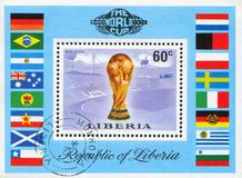 Worls soccer championship cup. LIBERIA - CIRCA 1974: stamp printed by Liberia, shows Worls soccer championship cup, Munich stadium and flags, circa 1974 royalty free stock images
