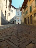 A worm's eye view of an uphill street in Bergamo, Italy royalty free stock image