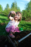 Worm. Girl finded worm on the land Royalty Free Stock Image