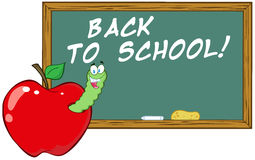 Worm In Apple In Front Of School Chalk Board Stock Image