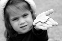 Worm. Child holds a worm on here hand Stock Photos
