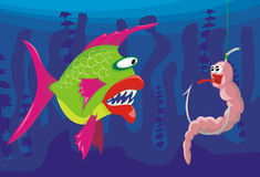 Worm and dangerous fish. Fishing with worms, worm mimics a fish Stock Image