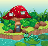 A worm near the red mushroom house Stock Photography