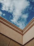 Worm's Eye View of Blue and White Sunny Cloudy Sky Royalty Free Stock Photography