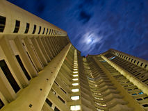 Worm's eye view of a condo. In the middle of the night Stock Photos