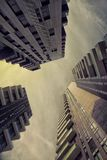 Worm's Eye View of High Rise Buildings Under Dim Lighted Sky Stock Photography
