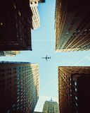 Worm's Eye View Photography Of Airplane And Buildings stock image