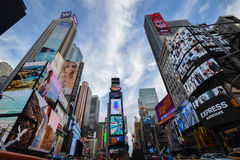 Worm's Eye View of Times Square Under Blue and White Sunny Cloudy Sky Royalty Free Stock Images