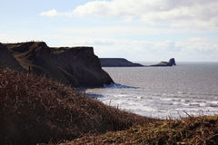 Worm's Head as seen from Rhossili Bay, Wales Stock Images