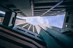 Worm's Eye View of City Buildings Under Blue and White Sunny Cloudy Sky Stock Images