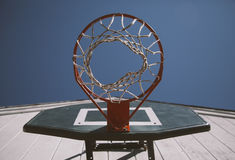 Worm's Eye View of Orange and Black Basketball Hoop Stock Images