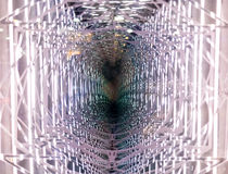 Wormhole like background or illusion. A background or texture of a mirrored optical illusion that looks like a worm hole stock image