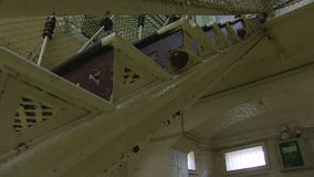 Stairs shot of a prison. A worms eye view shot of stairs of a prison. Camera moves forward and backwards stock video footage