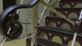 Stairs shot of a prison. A worms eye view shot of stairs of a prison. Camera moves to the left stock video footage