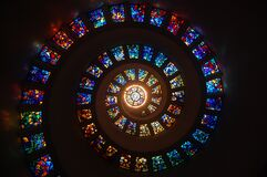 Worms Eye View of Spiral Stained Glass Decors Through the Roof Royalty Free Stock Images